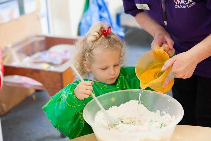 Playing with mixing bowl at Townhill Nursery & Pre-school