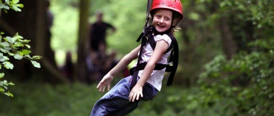 Child in harness on aerial runway