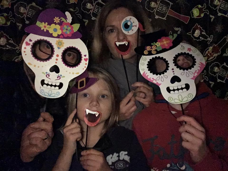 Family wearing Halloween masks