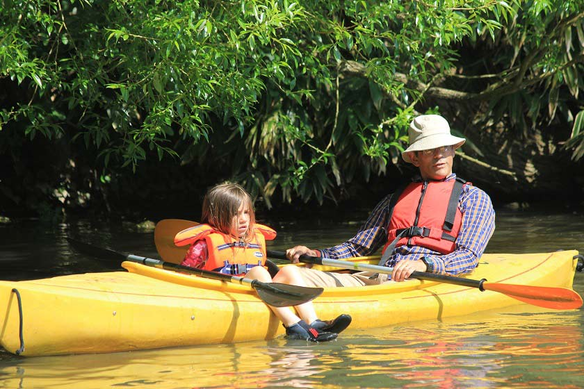 Adult and child in kayak