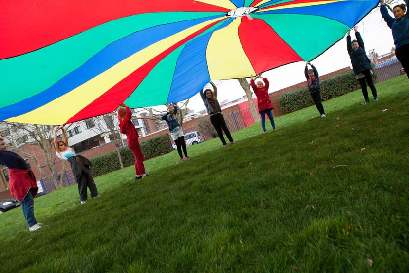 Playing parachute games at one of the Portsmouth daycamps.