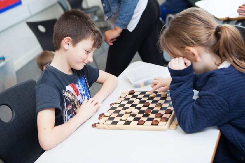 Children playing a board game at one of the Southampton Daycamps.