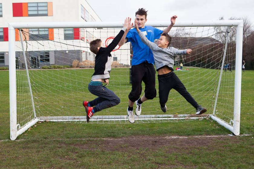 Celebrating in a football goal at one of the Southampton Daycamps.