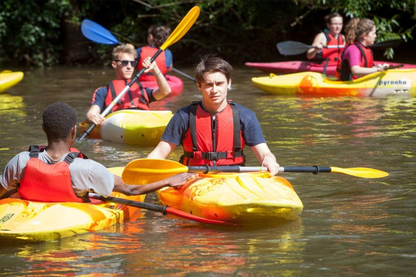 Kayaking during one of our residential camps as part of a Global Young Leadership programme.