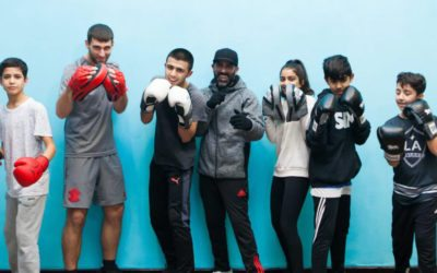 Girls and boys wearing boxing gloves