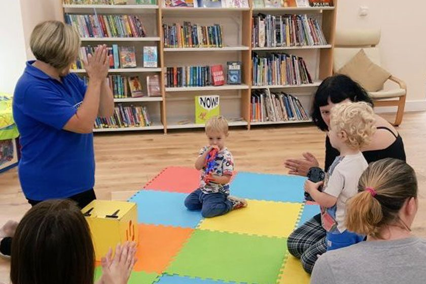 Clapping hands with children at Weston Library