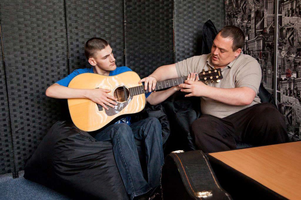 Playing guitar at our Southampton housing.