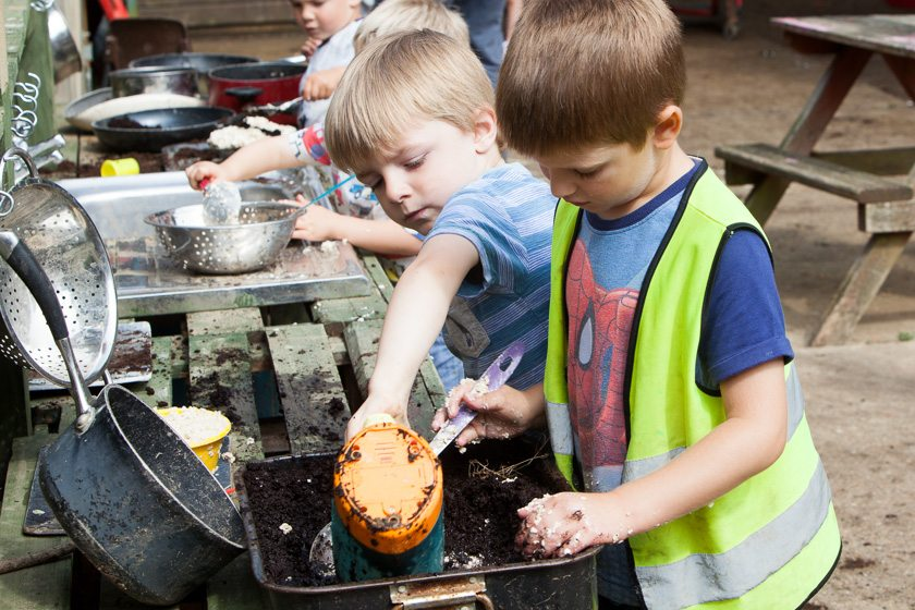 Children outdoors; cooking