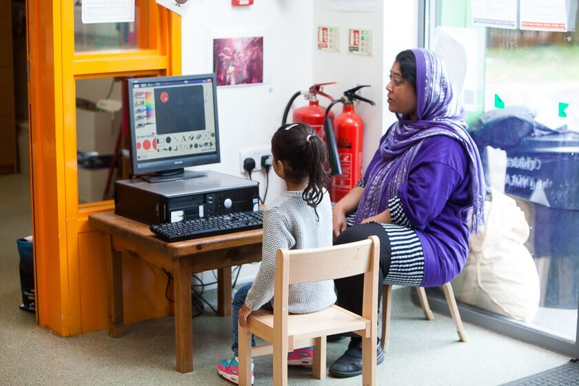 Using computer at Newtown Pre-school